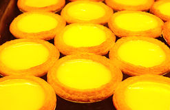 Egg tarts. Pastry arranged in rows ready to serve Stock Image