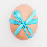 Egg tied with a ribbon Royalty Free Stock Photos