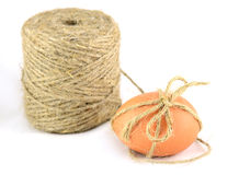 Egg tied with twine Royalty Free Stock Photos