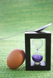 Egg timer and boiled egg Stock Photography