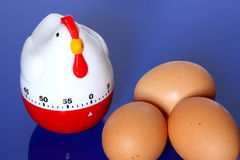 Egg timer and eggs Stock Photography