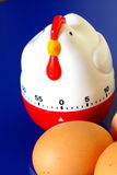 Egg timer and eggs Royalty Free Stock Photo