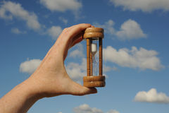Egg timer in hand Stock Photography