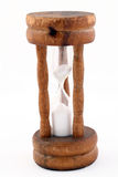 Egg timer hour glass in wooden frame. Closeup of small egg timer hour glass in wooden frame royalty free stock images