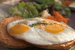 Egg toast. Toast with an egg sunny side up Stock Images