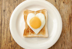 Egg and toasted bread Stock Photos