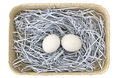 Egg tray packages made of recycled paper full of fresh eggs isol Stock Photos