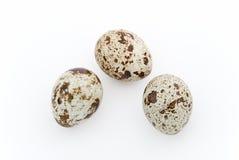 Egg triangle. Three quails egg triangle on white background Stock Photo