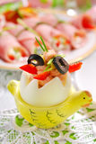 Egg with tuna spread and olives for easter breakfast Stock Photo