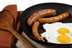Egg and veal sausage breakfast isolated Royalty Free Stock Photos