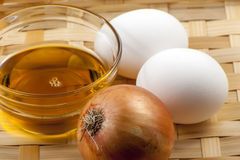 Egg and vegetable oil Stock Image