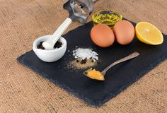 Egg and vegetable oil and other ingredients for the production of homemade mayonnaise. Organic products for the preparation of mayonnaise royalty free stock photography