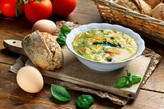 Egg vegetable soup. Bowl of home made egg soup with vegetables Royalty Free Stock Image