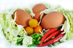 Egg and vegetables. Collection of vegetables and  egg on white backgroun Royalty Free Stock Photography