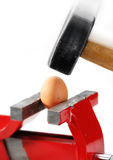 Egg, vise and hammer Royalty Free Stock Photos
