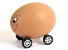 Egg on wheels2. Egg on wheels with smiley face Stock Image