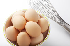 Egg and whisk Stock Photos