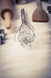 Egg whisk and bake tools on wooden background, close up Royalty Free Stock Image