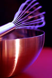Egg whisk and metal bowl Royalty Free Stock Photos