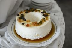 egg white pudding with sugar syrup and dried fruit on an ornate round dish. royalty free stock photos
