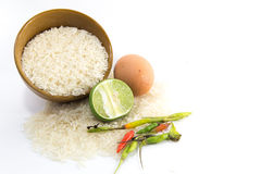Egg on White rice. Red chili and limes isolated on white Stock Image