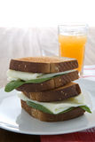 Egg white sandwich. On wheat toast, green spinach, and fresh squeezed orange juice Stock Photo