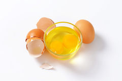 Egg whites and yolks in glass bowl Royalty Free Stock Images
