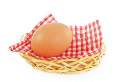 Egg in wicker basket with a checkered napkin Royalty Free Stock Images