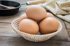 Egg in wicker basket Royalty Free Stock Images