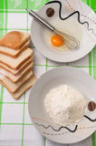 Egg, wire, bread and fluor on the kitchen table.  Stock Images