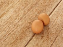 Egg on wooden background. Eggs lay on wooden background. Food ingredient Stock Image