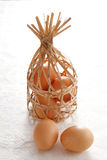 Egg in wooden basket Stock Photography
