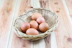 The egg in wooden basket Stock Photo