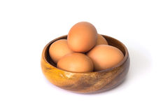 Egg in a wooden bowl isolated on white background Stock Photos