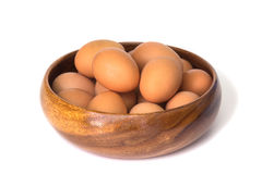 Egg in a wooden bowl isolated on white background Royalty Free Stock Photography