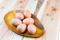 Egg wooden fork on white background Stock Photo