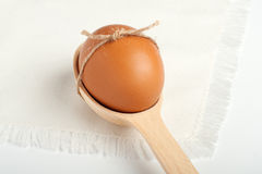 Egg in a wooden spoon Royalty Free Stock Image