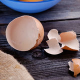 Egg on a wooden table. Egg in a blue plate on a wooden table illuminated side light Royalty Free Stock Photography