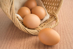An egg on wooden table and eggs in wicker basket Royalty Free Stock Photos