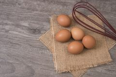Egg on wooden table, Top view and copy space for product display. Montage Royalty Free Stock Photo