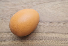 Egg on a wooden top Royalty Free Stock Photo