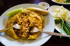 Egg wrapped pad thai on a plate in restaurant. Egg wrapped pad thai served on a plate in restaurant stock photos