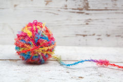 Egg of yarn on wood Stock Photos