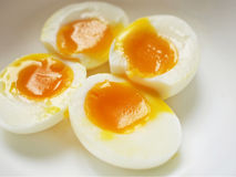 Egg yolk. Four pieces of soft boiled eggs with squidgy yolk Royalty Free Stock Photo