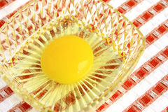 Egg yolk. In a glass container Stock Photography