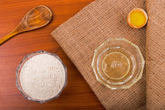 Egg yolk and albumen on a wooden table. Horizontal Stock Photography