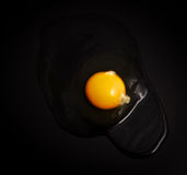Egg yolk on black background Royalty Free Stock Photography