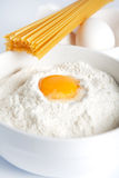 Egg yolk in a bowl of flour Stock Photos