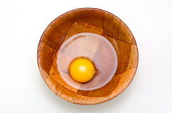 Egg yolk and egg white. In closeup over white background Royalty Free Stock Photo