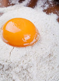 Egg yolk on flour Stock Photo